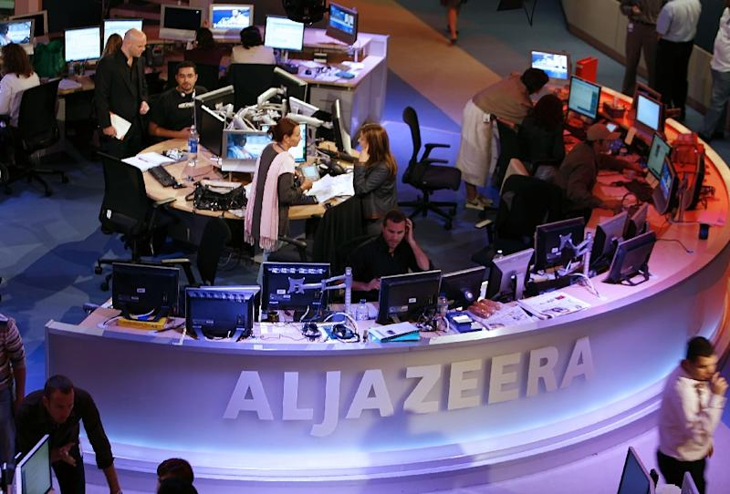 A general view shows the newsroom at the headquarters of the Qatar-based Al-Jazeera satellite channel in Doha 14 November 2006