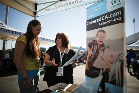 People at event to inform people about the Affordable Care Act and donate turkeys to 5,000 needy families, in Los Angeles