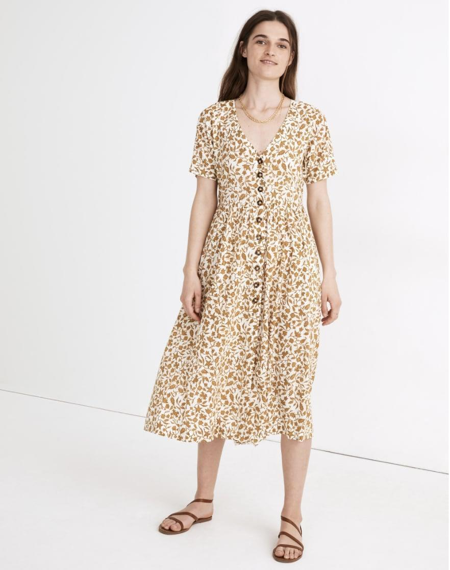 <p>This <span>Button-Front Midi Dress</span> ($100, originally $128) is made in a lightweight and sustainable cotton blend that pairs well with balmy summer picnics. You'll feel comfy and stylish when wearing it.</p>