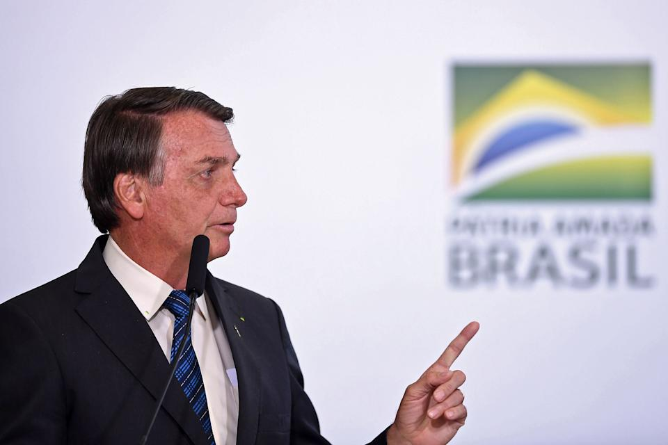 Brazilian President Jair Bolsonaro delivers a speech during a ceremony to launch the Genomas Project at Planalto Palace in Brasilia on October 14, 2020. - The Genomas Project aims at making a population study to identify rare diseases by sequencing the DNA of 100,000 Brazilians. (Photo by EVARISTO SA / AFP) (Photo by EVARISTO SA/AFP via Getty Images)