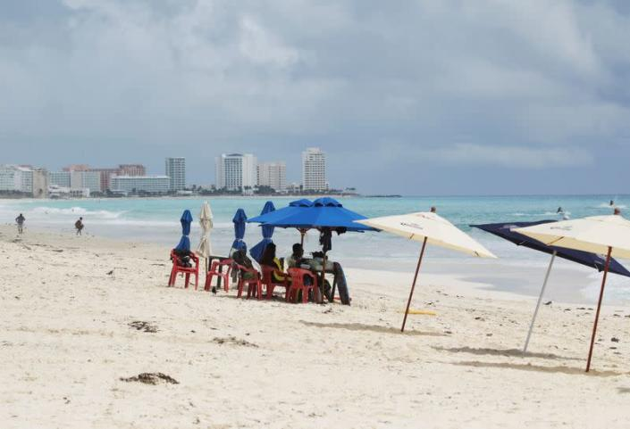 FILE PHOTO: Tourists are seen at a beach in Cancun