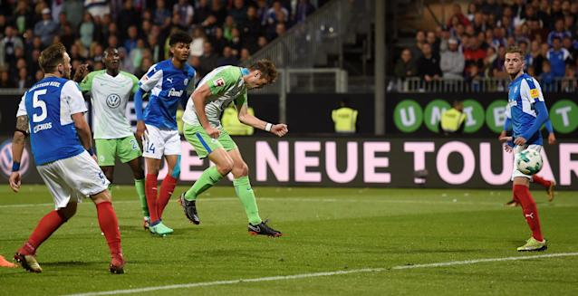 Soccer Football - Bundesliga Promotion/Relegation Playoff Second Leg - Holstein Kiel vs VfL Wolfsburg - Holstein-Stadion, Kiel, Germany - May 21, 2018 Wolfsburg's Robin Knoche scores their first goal REUTERS/Fabian Bimmer DFL RULES TO LIMIT THE ONLINE USAGE DURING MATCH TIME TO 15 PICTURES PER GAME. IMAGE SEQUENCES TO SIMULATE VIDEO IS NOT ALLOWED AT ANY TIME. FOR FURTHER QUERIES PLEASE CONTACT DFL DIRECTLY AT + 49 69 650050