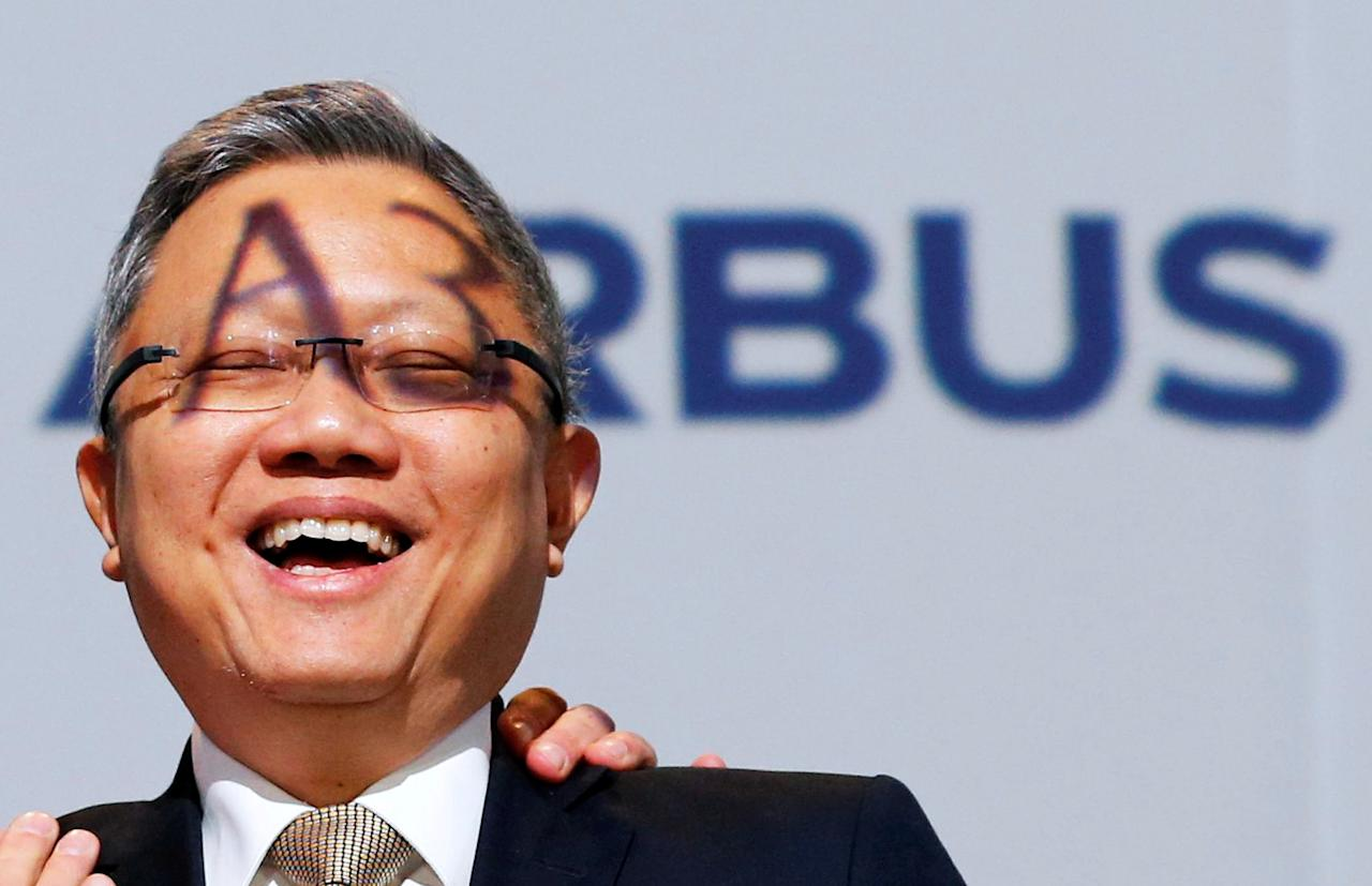 Mak Swee Wah, Executive Vice President of Commercial at Singapore Airlines, reacts as he attends a ceremony during the delivery of the new Airbus A380 aircraft to Singapore Airlines at the French headquarters of aircraft company Airbus in Colomiers near Toulouse, France, December 13, 2017. REUTERS/Regis Duvignau     TPX IMAGES OF THE DAY