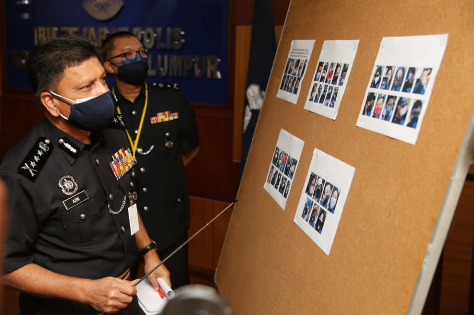 Kuala Lumpur police chief Datuk Azmi Abu Kassim showing pictures of participants of the #KeluarDanLawan demo at the Kuala Lumpur Contingent Police Headquarters, August 2, 2021. ― Picture by Choo Choy May