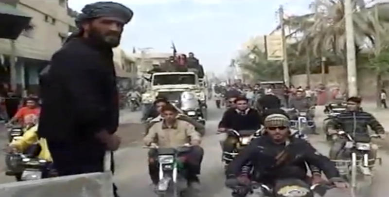 This citizen journalist image made from video provided by Shaam News Network which has been authenticated based on its contents and other AP reporting, shows Syrian rebels celebrating the takeover of Mayadeen military base near Deir el-Zour, Thursday, Nov. 22, 2012. Syrian rebels strengthened their hold in an oil-rich strategic province bordering Iraq, capturing a key military base that was considered the last bastion for regime forces in the area. (AP Photo/Shaam News Network via AP video)