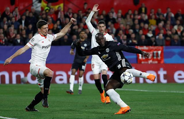 Soccer Football - Champions League Round of 16 First Leg - Sevilla vs Manchester United - Ramon Sanchez Pizjuan, Seville, Spain - February 21, 2018 Manchester United's Romelu Lukaku in action with Sevilla's Clement Lenglet REUTERS/Juan Medina