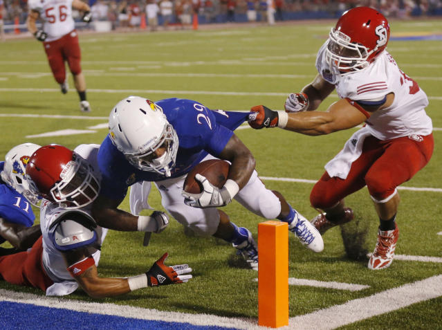 South Dakota linebacker Colin Buscarini, right, and defensive back Tevin Foster, left, fail to keep Kansas running back James Sims (29) out of the end zone during the second half of an NCAA college football game in Lawrence, Kan., Saturday, Sept. 7, 2013. Sims scored on the play. (AP Photo/Orlin Wagner)