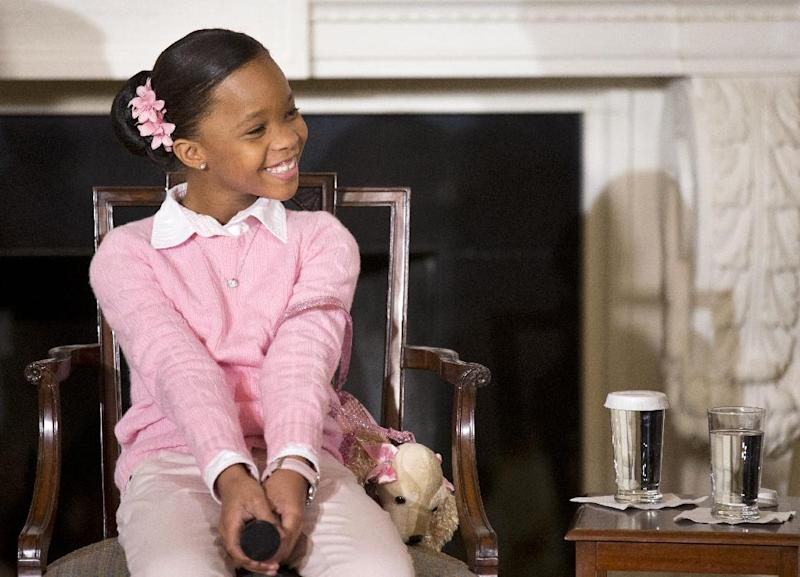The film Beasts of the Southern Wild actress Quvenzhané Wallis smiles in the State Dining Room of the White House in Washington, Wednesday, Feb. 13, 2013, attended by middle and high school students from the District of Columbia area and New Orleans taking part in an interactive student workshop with the cast and crew of the movie, hosted by first lady Michelle Obama. (AP Photo/Manuel Balce Ceneta)