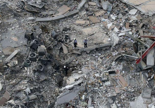 PHOTO: Search and rescue personnel work in the rubble of the 12-story condo tower that crumbled to the ground during a partially collapse of the building, June 24, 2021, in Surfside, Fla., near Miami Beach. (Joe Raedle/Getty Images)