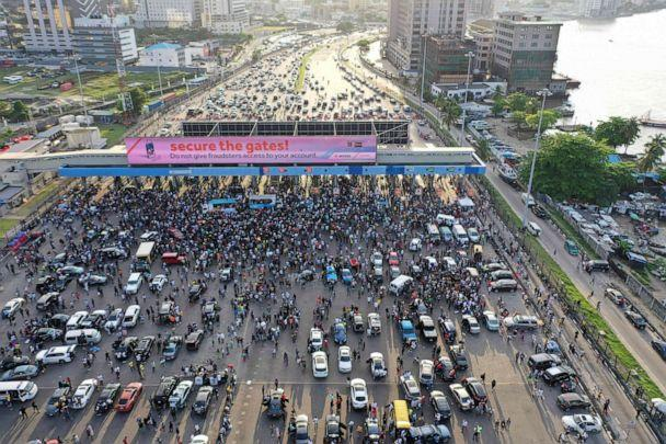 PHOTO: An aerial view shows protesters gathering at the Lekki toll gate in Lagos, Nigeria, on Oct. 15, 2020, during a demonstration against police brutality and the now-disbanded Special Anti-Robbery Squad (SARS). (Pierre Favennec/AFP via Getty Images)