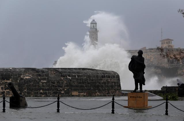 <p>Waves crash against the lighthouse after the passing of Hurricane Irma, in Havana, Cuba, Sept. 10, 2017. (Photo: Stringer/Reuters) </p>