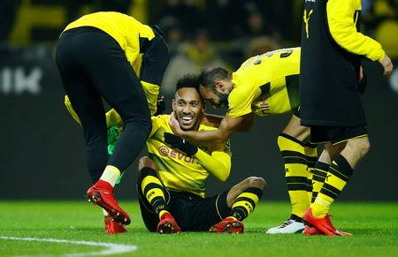Soccer Football - Bundesliga - Borussia Dortmund vs TSG 1899 Hoffenheim - Signal Iduna Park, Dortmund, Germany - December 16, 2017 Borussia Dortmund's Pierre-Emerick Aubameyang and Omer Toprak celebrate after the match REUTERS/Leon Kuegeler/Files