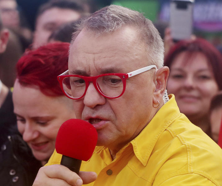 Jerzy Owsiak, founder and leader, of the Great Orchestra of Christmas Charity, one of Poland's largest charities organizations, speaks during the finale of a yearly fundraiser, in Warsaw, Poland, Sunday, Jan. 12, 2020. The charity raises money for life-saving medical equipment for public hospitals, and is a beloved tradition among many Poles. (AP Photo/Czarek Sokolowski)