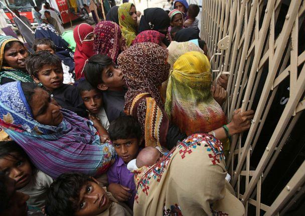 PHOTO: Villagers wait outside a hospital for blood screening in the southern province of Sindh, Pakistan, May 16, 2019, where about 500 people, mostly children, have tested positive for HIV. (Fareed Khan/AP)