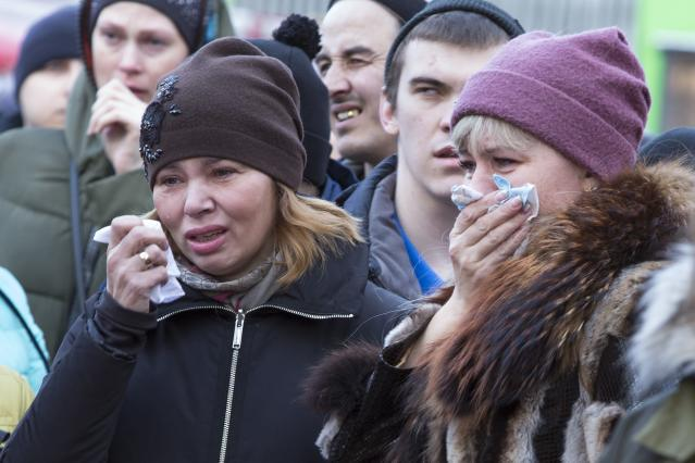 <p>People react after laying flowers for the victims of a fire in a multistory shopping center in the Siberian city of Kemerovo, about 3,000 kilometers (1,900 miles) east of Moscow, March 26, 2018. Russian officials say a fire at the shopping mall killed over 50 people. (AP Photo/Sergei Gavrilenko) </p>