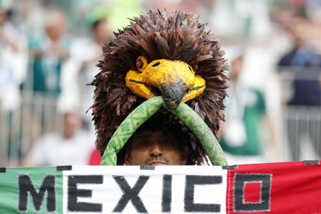 A Mexican soccer supporter poses for a picture ahead of the group F match between Germany and Mexico at the 2018 soccer World Cup in the Luzhniki Stadium in Moscow, Russia, Sunday, June 17, 2018. (AP Photo/Antonio Calanni)