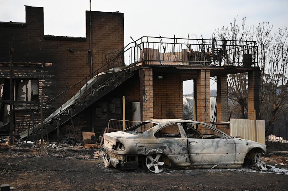 A house and vehicle gutted by bushfires are seen in the town of Lake Conjola in New South Wales on January 1, 2020. - A major operation to reach thousands of people stranded in fire-ravaged seaside towns was under way in Australia on January 1 after deadly bushfires ripped through popular tourist spots and rural areas leaving at least eight people dead. (Photo by PETER PARKS / AFP) (Photo by PETER PARKS/AFP via Getty Images)