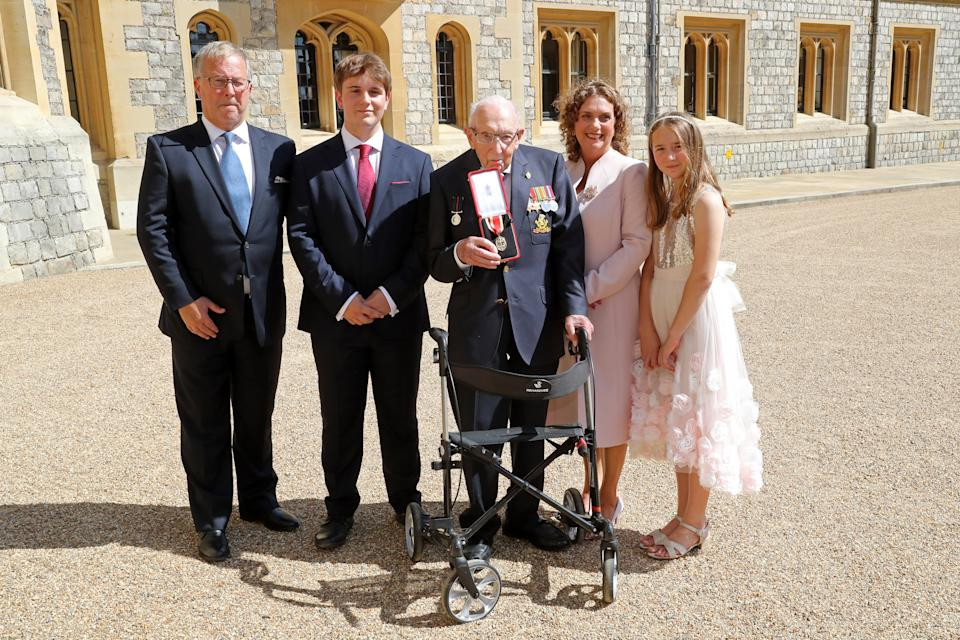 WINDSOR, ENGLAND - JULY 17: Captain Sir Thomas Moore poses with his family after being awarded with the insignia of Knight Bachelor by Queen Elizabeth II at Windsor Castle on July 17, 2020 in Windsor, England. British World War II veteran Captain Tom Moore raised over £32 million for the NHS during the coronavirus pandemic.  (Photo by Chris Jackson/Getty Images)