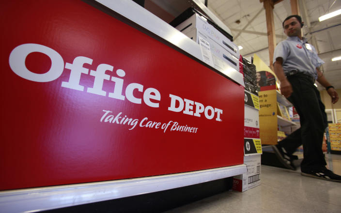 FILE - This July 12, 2010, file photo shows signage at an Office Depot store in Mountain View, Calif. Office Depot and Alibaba.com are creating a co-branded online store to expand the reach of both companies with small and medium size businesses. The two companies announced the agreement Monday, March 4, 2019, as part of a broader array of services they are providing to small business. Over time, the companies intend to help U.S. small businesses sell their products to buyers around the world through Alibaba.com. It marks Alibaba.com's first U.S. partnership with a major company. (AP Photo/Paul Sakuma, File)