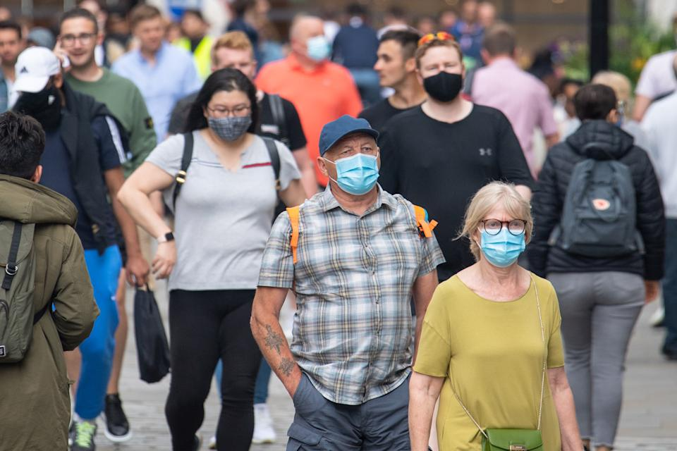 People wearing face masks among crowds of pedestrians in Covent Garden, London. Rumours were abound in the Sunday newspapers that Prime Minister Boris Johnson, who is due to update the nation this week on plans for unlocking, is due to scrap social distancing and mask-wearing requirements on so-called