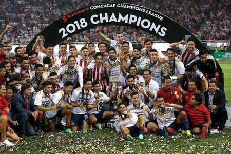 Soccer Football - CONCACAF Champions League Final Second Leg - Guadalajara vs Toronto FC - Estadio Akron, Guadalajara, Mexico - April 25, 2018 Guadalajara players celebrate winning the CONCACAF Champions League Final with the trophy REUTERS/Henry Romero
