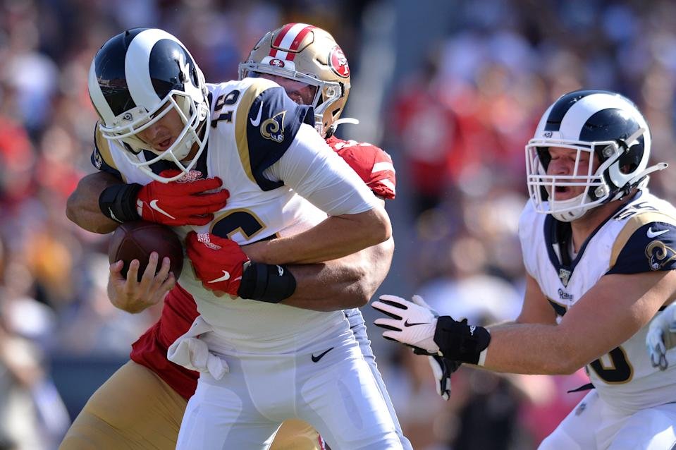 Oct 13, 2019; Los Angeles, CA, USA; Los Angeles Rams quarterback Jared Goff (16) is sacked by San Francisco 49ers defensive end Solomon Thomas (94) during the second half at Los Angeles Memorial Coliseum. Mandatory Credit: Orlando Ramirez-USA TODAY Sports