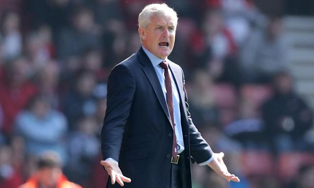 Southampton manager Mark Hughes urges on his team during the defeat against Chelsea.