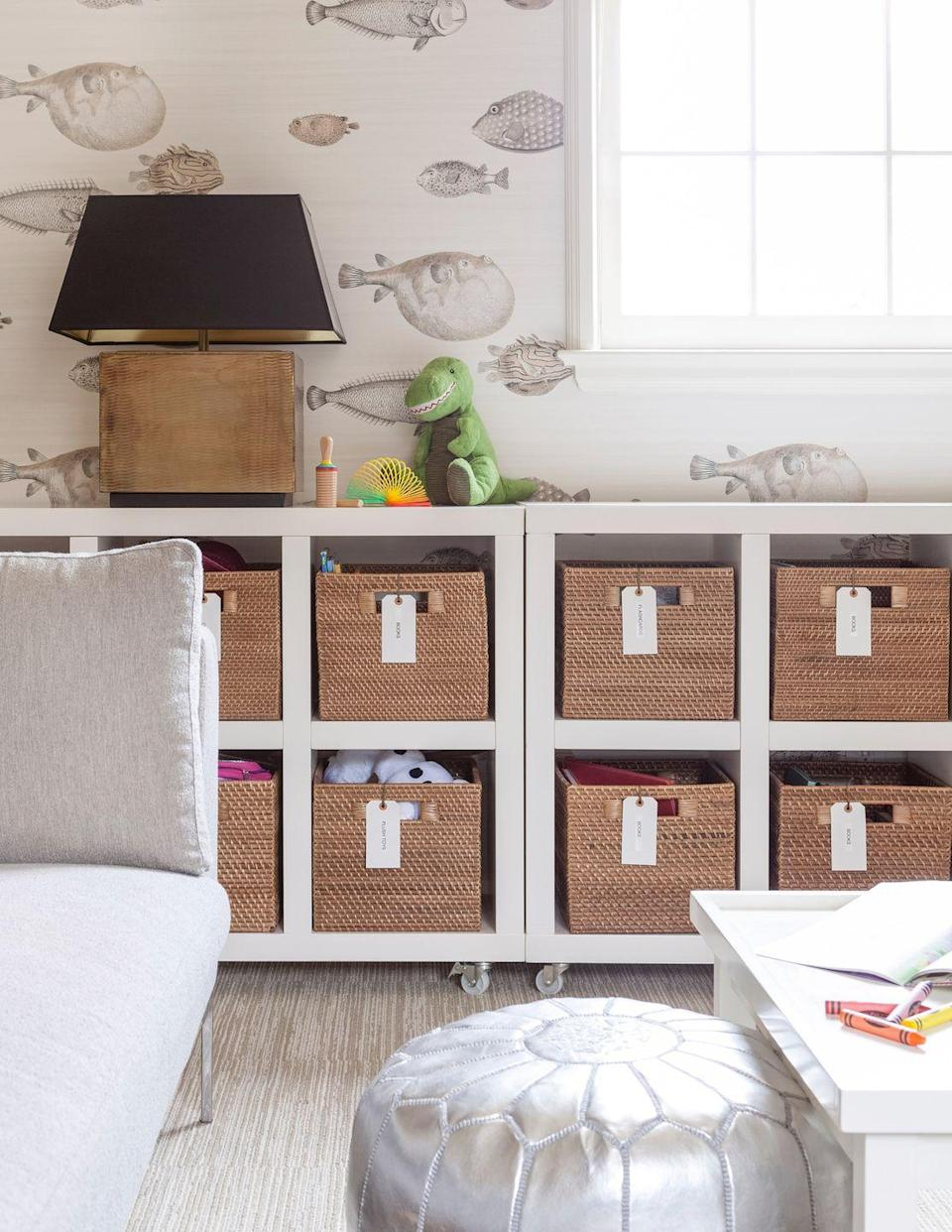 """<p>Help your teen stay organized with bins and baskets complete with labels. This will help keep the room clean and stylish. We're also loving the mix of whimsy and sophistication in this teenager's bedroom designed by <a href=""""https://www.jeanliudesign.com/"""" rel=""""nofollow noopener"""" target=""""_blank"""" data-ylk=""""slk:Jean Liu"""" class=""""link rapid-noclick-resp"""">Jean Liu</a>, namely, the blowfish wallpaper and metallic accents. </p>"""
