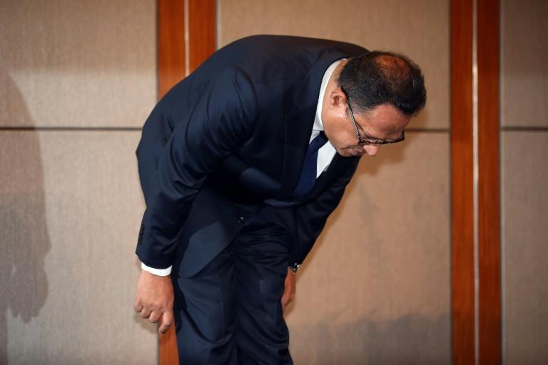 Atar Safdar, the head of Oxy Reckitt Benckiser Korea, bows during a press conference in Seoul on May 2, 2016