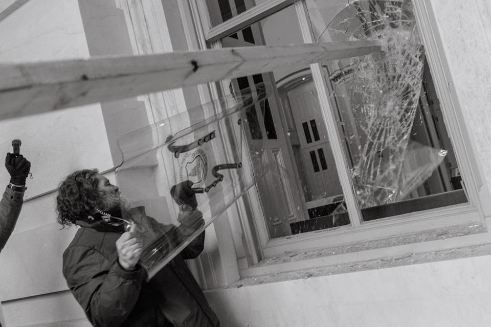 "Pro-Trump rioter uses a Capitol Police shield to break a window of the U.S. Capitol in Washington, D.C.<span class=""copyright"">Christopher Lee for TIME</span>"