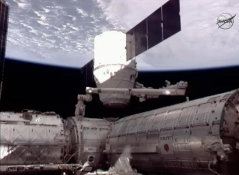 This framegrab image from NASA-TV shows the SpaceX Dragon capsule, center, the U.S. Destiny lab, left and the Japanese Kibo module, right just after the Dragon capsule was dematted from the International Space Station Thursday May 31, 2012. (AP Photo/NASA)