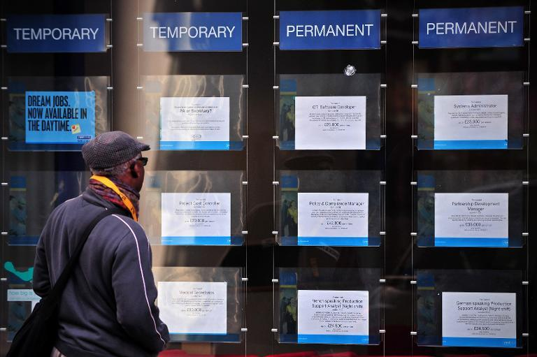 Britain's jobless rate for October-December was down from 5.8 percent for the three months to the end of November, its lowest level August 2008, the Office for National Statistics (ONS) said in a statement (AFP Photo/Carl Court)
