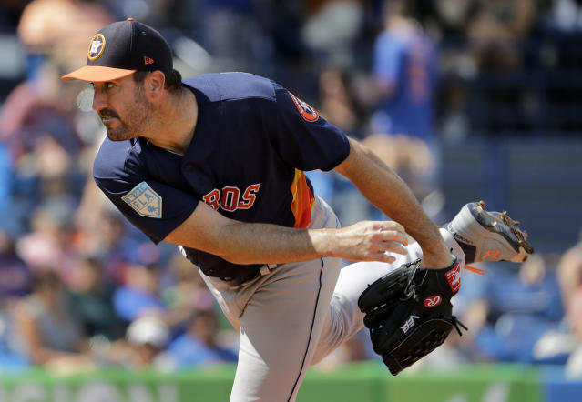Houston Astros starting pitcher Justin Verlander throws during the first inning of an exhibition spring training baseball game against the New York Mets, Saturday, March 2, 2019, in Port St. Lucie, Fla. (AP Photo/Jeff Roberson)