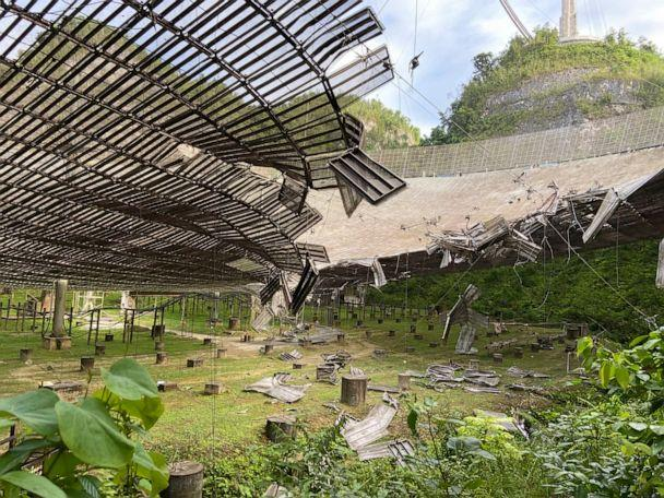 PHOTO: In this Tuesday, Aug. 11, 2020, file photo, provided by the Arecibo Observatory, shows the damage done by a broken cable that supported a metal platform, creating a 100-foot gash to the radio telescope's reflector dish in Arecibo, Puerto Rico. (Arecibo Observatory via AP, File)