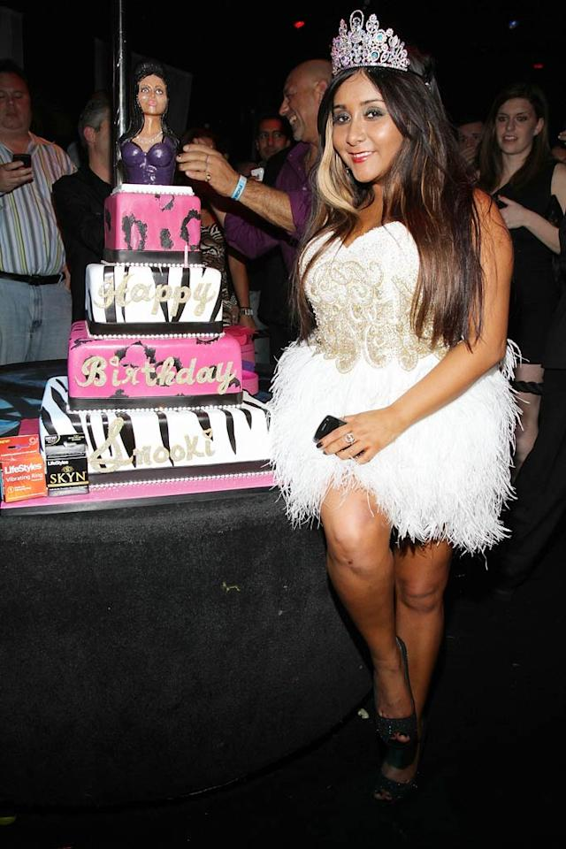 """Also ringing in a birthday was """"Jersey Shore"""" star Snooki, who turned 23 on November 23. The orange-hued reality starlet partied at Pacha in NYC sporting a feathered frock and tiara -- the perfect outfit for the Princess of Poughkeepsie! Jerritt Clark/<a href=""""http://www.wireimage.com"""" target=""""new"""">WireImage.com</a> - November 20, 2010"""