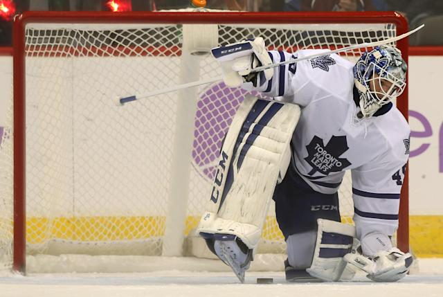 Toronto Maple Leafs goalie Jonathan Bernier reacts after giving up a goal to Colorado Avalanche center Matt Duchene in the shootout of the Avalanche's 4-3 victory in an NHL hockey game in Denver on Thursday, Nov. 6, 2014. (AP Photo/David Zalubowski)