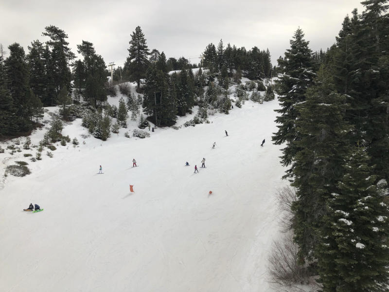 Skiers take to the slopes at Snow Summit ski resort in Big Bear Lake, Calif., on Friday, Feb. 1, 2019. A powerful storm heading toward California is expected to produce heavy rainfall, damaging winds, localized stream flooding and heavy snow in the Sierra Nevada. Forecasters say rain will arrive in the north late Friday afternoon and reach the south late in the night, and last through Saturday night. (AP Photo/Christopher Weber)