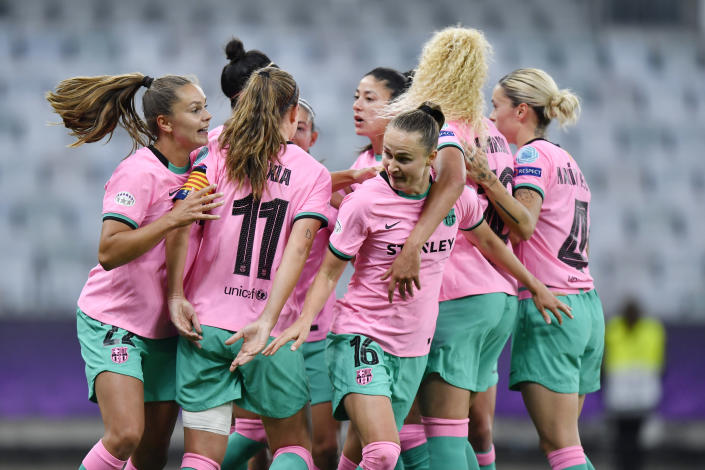 Barcelona's Caroline Graham Hansen, center, celebrates after scoring her side's fourth goal during the UEFA Women's Champions League final soccer match between Chelsea FC and FC Barcelona in Gothenburg, Sweden, Sunday, May 16, 2021. (AP Photo/Martin Meissner)