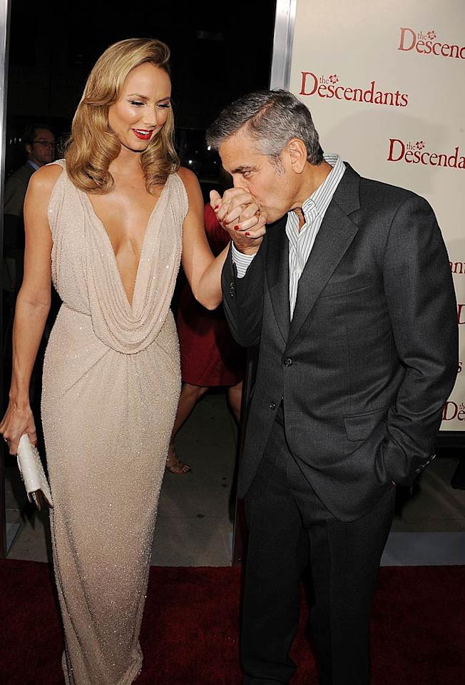 """Another past """"Dancing With the Stars"""" contestant, former pro wrestler Stacy Keibler, got quite the gentlemanly greeting from her main squeeze George Clooney at """"The Descendants"""" L.A. premiere in Beverly Hills on Tuesday night."""