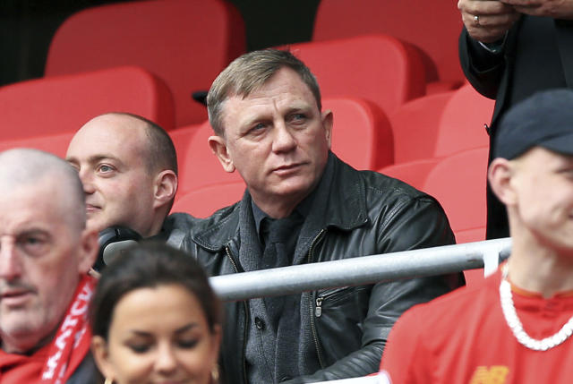 <p>British actor Daniel Craig, centre, sits in the stands, ahead of the English Premier League soccer match between Liverpool and Everton, at Anfield, in Liverpool, England, Saturday April 1, 2017. (Peter Byrne/PA via AP) </p>
