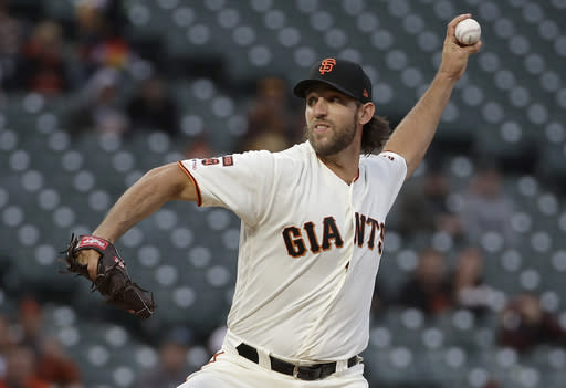San Francisco Giants pitcher Madison Bumgarner throws against the San Diego Padres during the first inning of a baseball game in San Francisco, Monday, April 8, 2019. (AP Photo/Jeff Chiu)