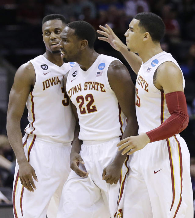 Iowa State forward Melvin Ejim (3), forward Dustin Hogue (22) and guard Naz Long (15) celebrate against North Carolina Central during the first half of a second-round game in the NCAA college basketball tournament Friday, March 21, 2014, in San Antonio. (AP Photo/Eric Gay)