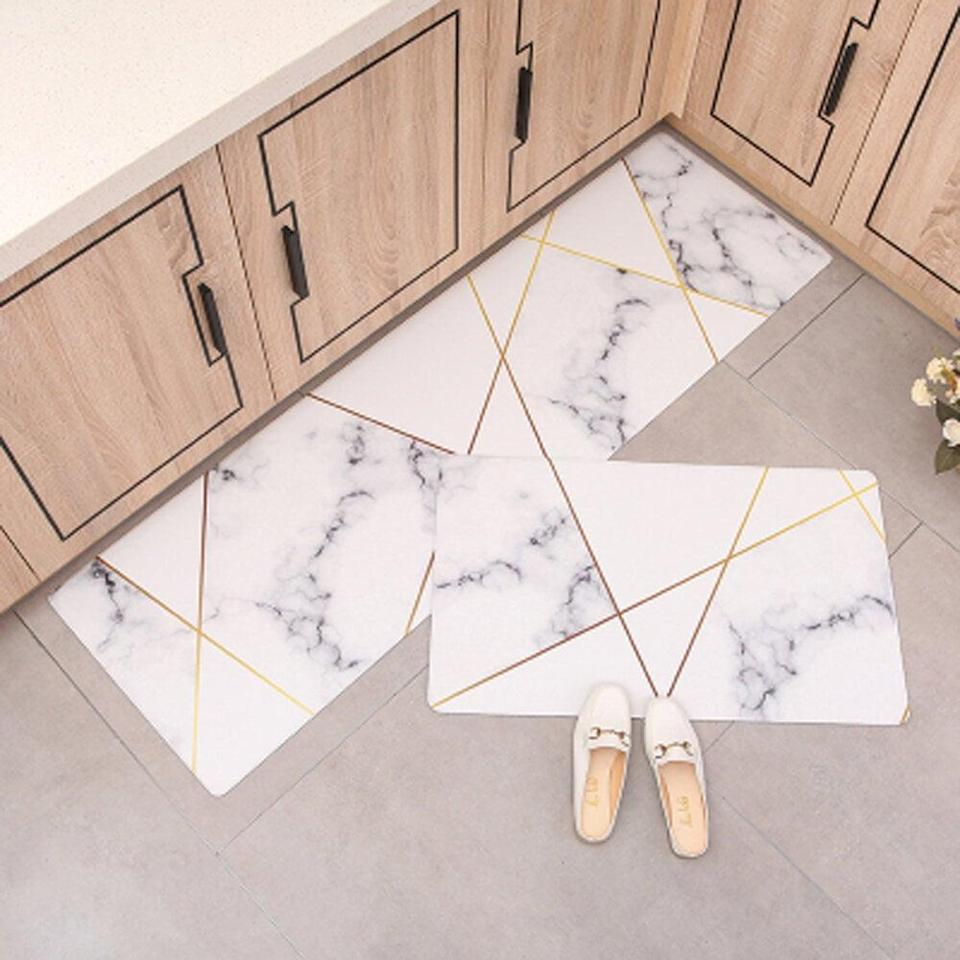 <p>Take the marble obsession to another level with this <span>Everly Quinn Rene Comfort Heavy Duty Standing 2 Piece Mat Set</span> ($66).</p>