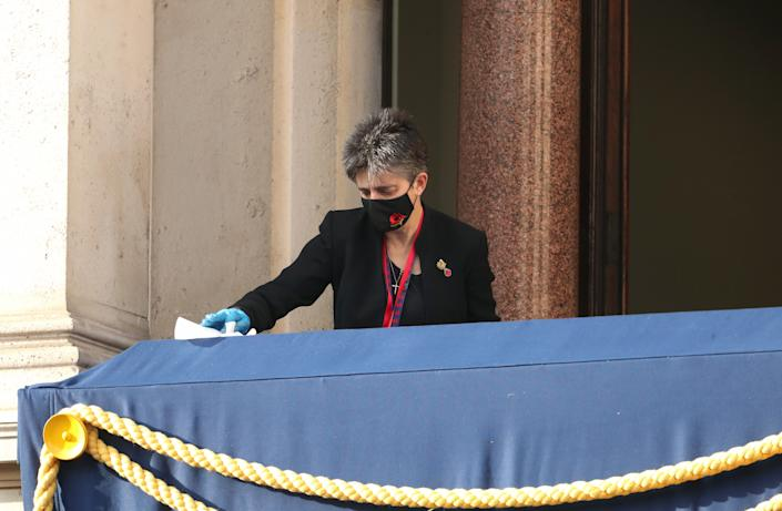 A worker wipes down the Royal box ahead of the the Remembrance Sunday ceremony at the Cenotaph on Whitehall in central London, on November 8, 2020. - Remembrance Sunday is an annual commemoration held on the closest Sunday to Armistice Day, November 11, the anniversary of the end of the First World War and services across Commonwealth countries remember servicemen and women who have fallen in the line of duty since WWI. This year, the service has been closed to members of the public due to the novel coronavirus COVID-19 pandemic. (Photo by Chris Jackson / POOL / AFP) (Photo by CHRIS JACKSON/POOL/AFP via Getty Images)