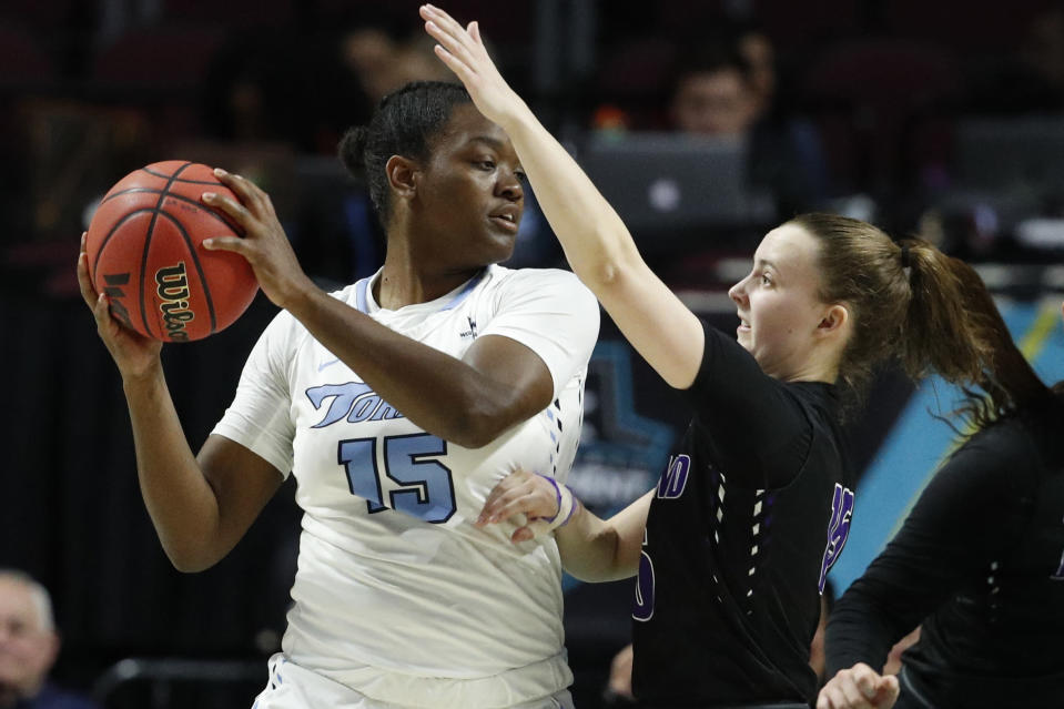 Portland's Maddie Muhlheim, right, guards San Diego's Leticia Soares during the first half of an NCAA college basketball game in the final of the West Coast Conference women's tournament Tuesday, March 10, 2020, in Las Vegas. (AP Photo/John Locher)