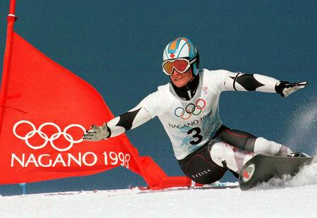 FILE PHOTO: Canada's Ross Rebagliati rides past a gate in the first run of the first Olympic snowboard giant sla..