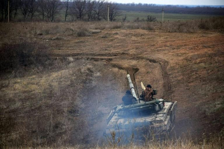 Ukrainian forces take part in a tank drill in Donbass region amid the largest deployment of Russian troops on Ukraine's borders since 2014