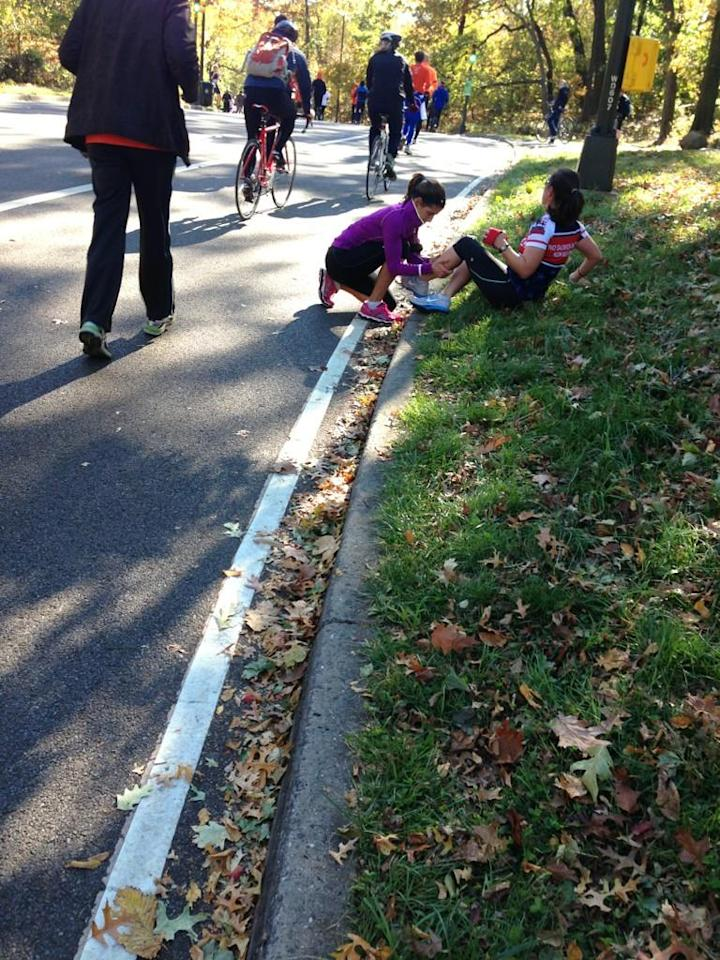 Stretching so they can finish the #unofficial #nycmarathon #teamwork