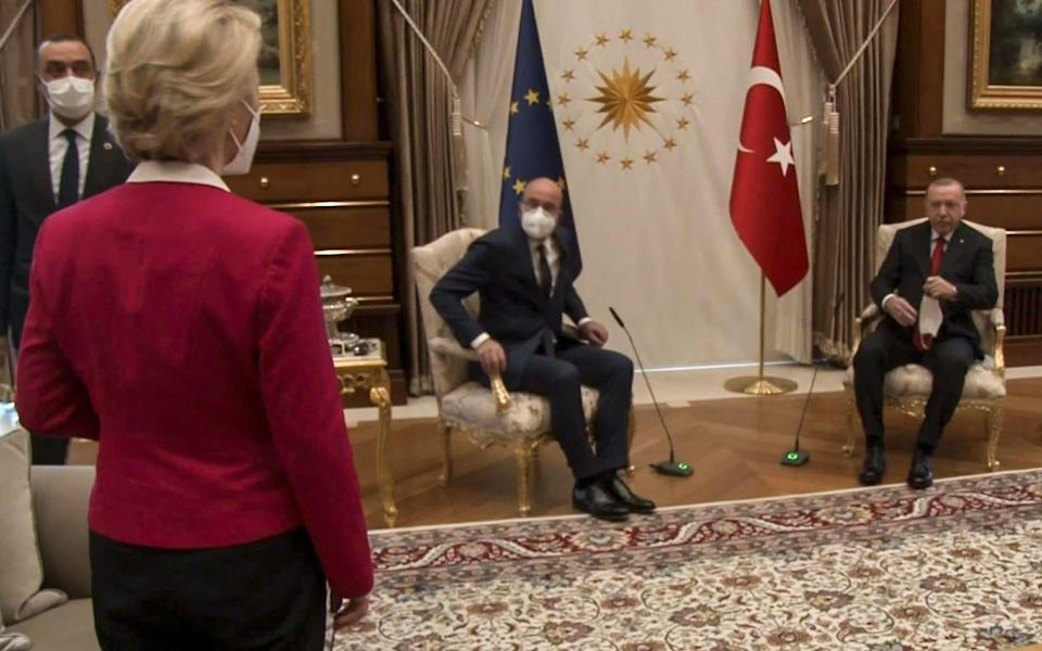 Ursula von der Leyen looks on as President Recep Tayyip Erdogan (R) and EU Council President Charles Michel take the only chairs in the room - AFP
