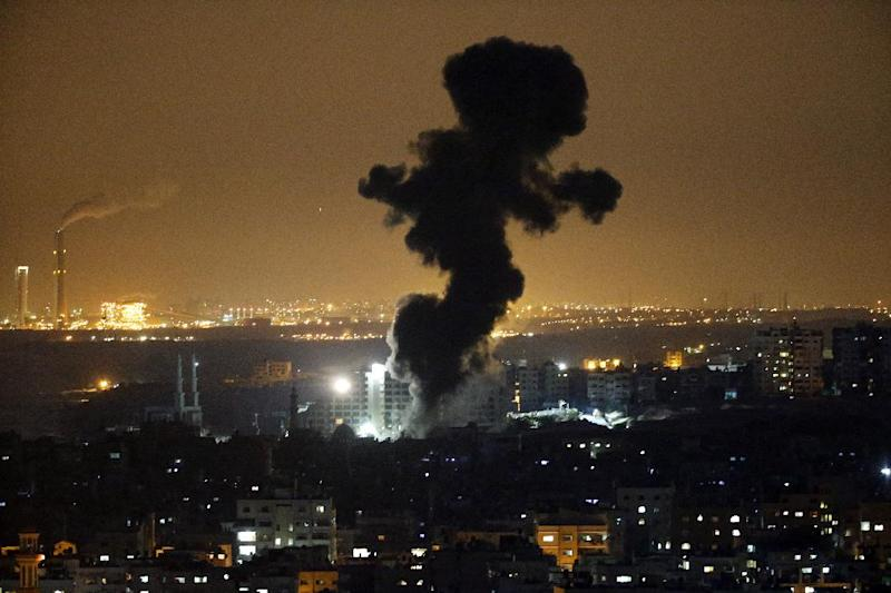 Smoke billows from buildings following an Israeli air strike in Gaza City on July 12, 2014